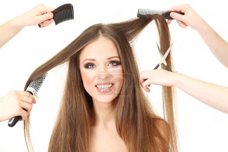 Woman with long hair in beauty salon, isolated on white