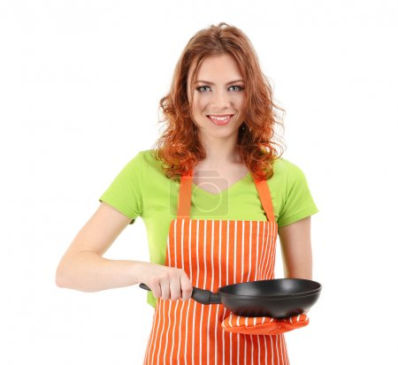 Photo for Young woman wearing kitchen apron with pan, isolated on white - Royalty Free Image