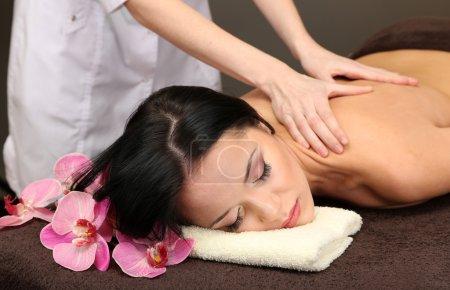 Woman in spa salon getting massage