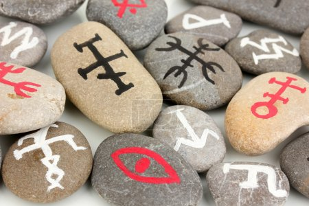 Fortune telling with symbols on stones close up