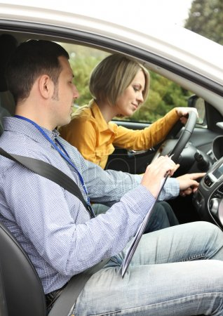 Photo for Learner driver student driving car with instructor - Royalty Free Image