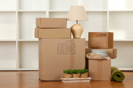 Photo for Moving boxes in empty room - Royalty Free Image