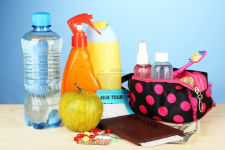 Travelling items on color background