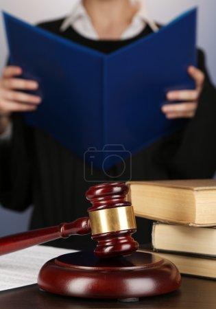 Judge read verdict on purple background