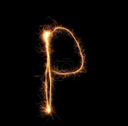 """Letter """"P"""" sparklers on black background"""