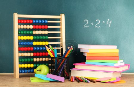 Photo for Toy abacus, books and pencils on table, on school desk background - Royalty Free Image