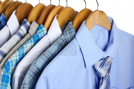Photo for Shirts with ties on wooden hangers close-up - Royalty Free Image