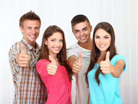 Photo for Group of happy beautiful young people at room - Royalty Free Image