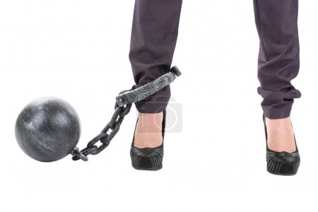 Business worker with ball and chain attached to foot isolated on white