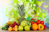 Assortment of fresh fruits and vegetables on natural background