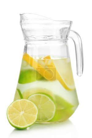 Photo for Cold water with lime, lemon and ice in pitcher isolated on white - Royalty Free Image