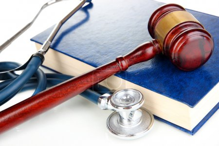 Medicine law concept. Gavel and stethoscope on boo...