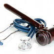 Medicine law concept. Gavel and stethoscope isolat...