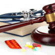Medicine law concept. Gavel and pills isolated on ...