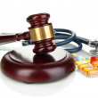 Medicine law concept. Gavel, stethoscope and pills...