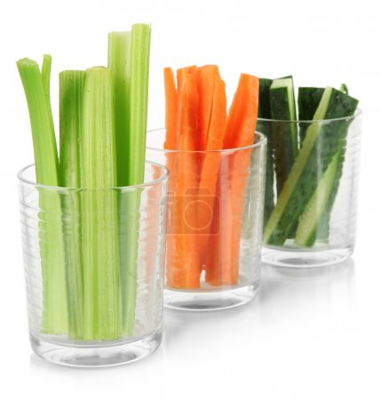 Photo for Fresh green celery with vegetables in glasses isolated on white - Royalty Free Image