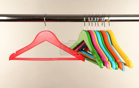 Photo for Colorful clothes hangers on gray background - Royalty Free Image