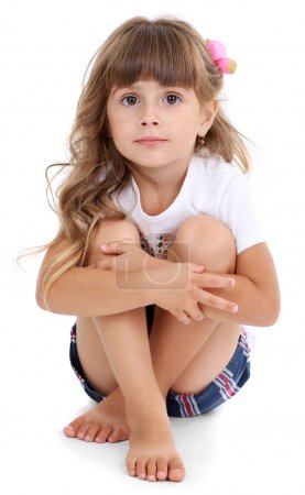 Little girl sitting on floor isolated on white
