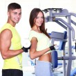 Guy and girl at gym...