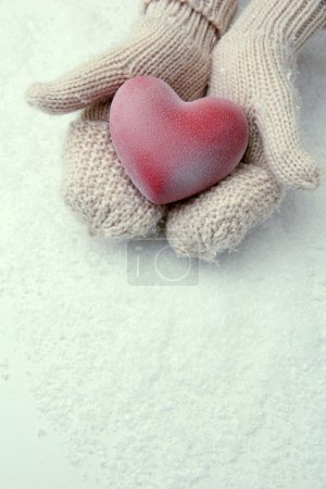 Photo for Female hands in mittens with red heart, close-up - Royalty Free Image