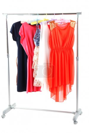 Photo for Beautiful dresses hanging on hangers isolated on white - Royalty Free Image