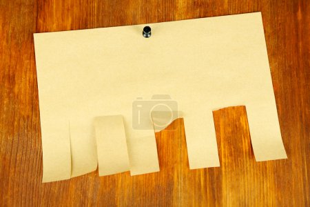 Paper ads on wooden background