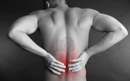 Young man with back pain in shades of grey