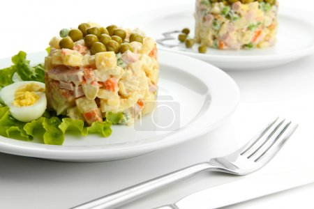 Russian traditional salad Olivier, isolated on whi...