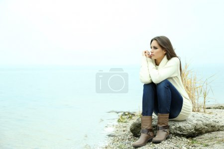 Photo for Portrait of young serious woman near river - Royalty Free Image