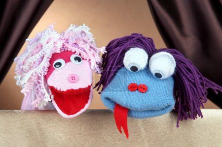Puppet show on brown background...