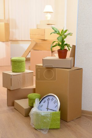 Photo for Empty room with stack of cartons: moving house concept - Royalty Free Image