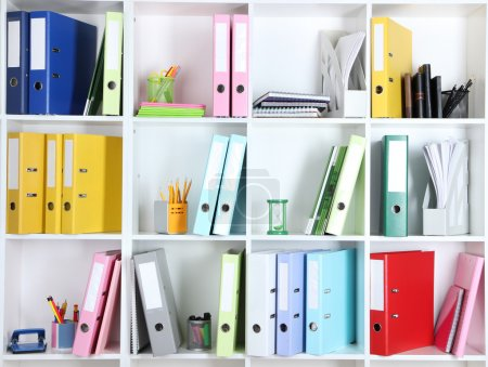 Photo for White office shelves with folders and different stationery, close up - Royalty Free Image