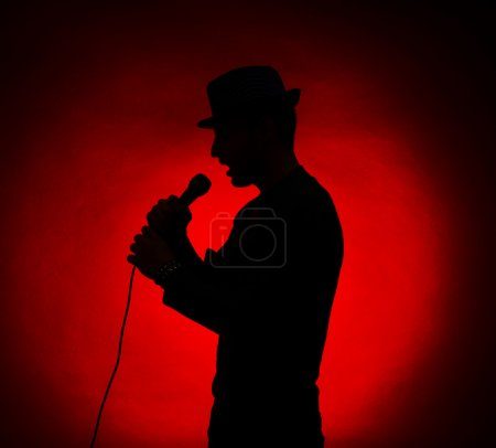 Photo for Musician silhouette on dark color background - Royalty Free Image