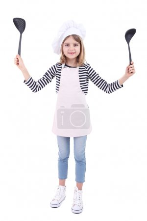 Beautiful little girl holding kitchen spoons isolated on white