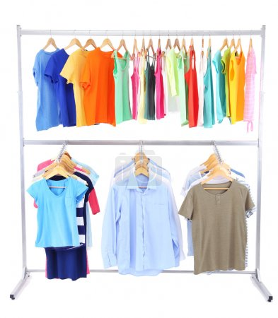 Photo for Different clothes on hangers, on gray background - Royalty Free Image