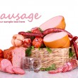 Lot of different sausages in basket isolated on wh...
