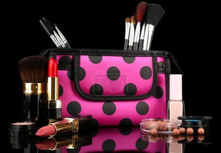 Professional make-up tools on black background