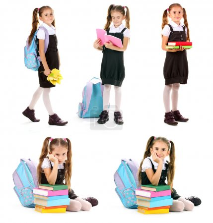 Cute little girl in school uniform isolated on white