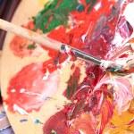 Artist paints picture close-up...