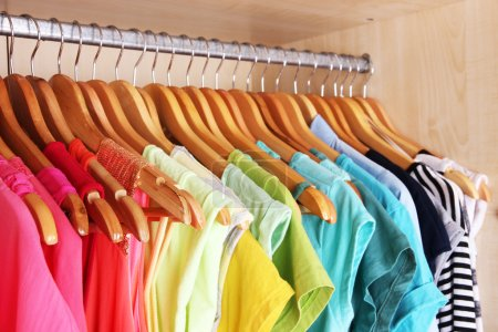 Photo for Colorful clothes hanging in wardrobe - Royalty Free Image
