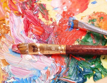 Paints, brush and art palette close-up...