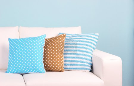 Photo for White sofa close-up in room on blue background - Royalty Free Image