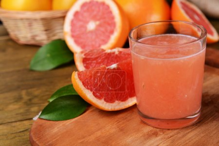 Photo for Ripe grapefruit with juice on table close-up - Royalty Free Image