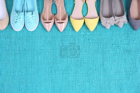 Photo for Female fashion shoes on blue carpet - Royalty Free Image