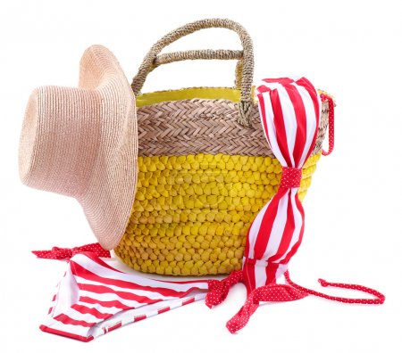 Wicker bag and swimsuit