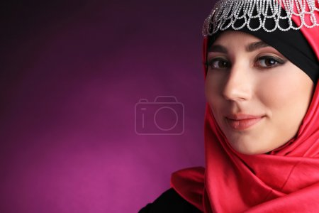 Photo for Beautiful muslim arabic woman on dark color background - Royalty Free Image