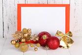 Vánoční přání na dřevěné pozadí