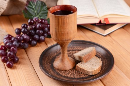 Cup of wine and bread on table close-up...