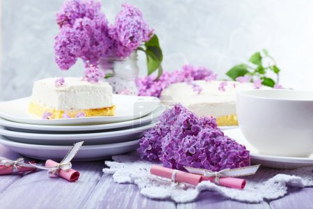 Photo for Delicious dessert with lilac flowers - Royalty Free Image