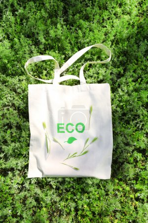 Photo for Eco bag on green grass, outdoors - Royalty Free Image